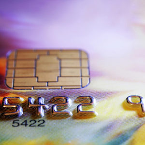 puple and yellow credit card showing a few digits